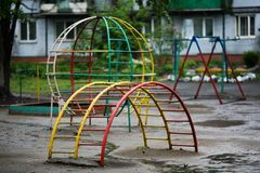 Old empty playground with metal structures for games stock photography
