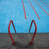Old empty pool with ladder Stock Photo