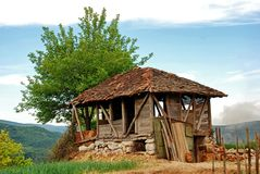 Old empty ruined house barrack on mountain Royalty Free Stock Image