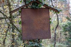 Old empty signboard in the middle of the forest royalty free stock image