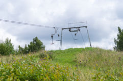 Old empty ski lift in summer landscape Stock Images