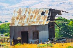 Old Empty Tin Barn In Disrepair. Old Abandoned Rusty Tin Roof Building In Disrepair Royalty Free Stock Photography