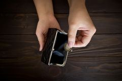 Old empty wallet in the hands .Vintage empty purse in hands of women . Poverty concept, Retirement.  stock photo