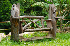Old empty wooden bench in the park in spring Royalty Free Stock Photo