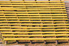 Old empty wooden benches at abandoned rural stadium Stock Photo
