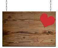Old empty wooden sign heart. Old  heart empty wooden sign hanging on an iron chain Stock Photos