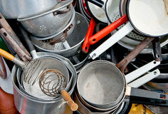 Old enameled and aluminum cookware Royalty Free Stock Photo