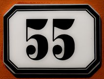 Number 55. Old enameled house sign with number fifty-five Stock Image
