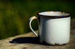 Old enameled mug Stock Image