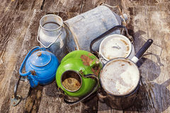 Old enamelled or aluminum cookware Stock Photos