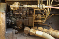 Old engine of grader car with oil engine leak Royalty Free Stock Image