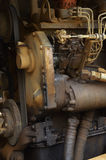 Old engine of grader car with oil engine leak Stock Photography