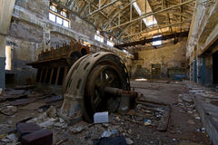 Old engine. View of an old engine in an abandoned industrial building Stock Photos