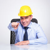 Old engineer at the desk points at you Stock Photography