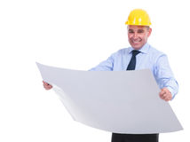 Old engineer holds project and smiles Royalty Free Stock Photos