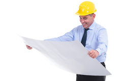 Old engineer looking at spread project Stock Images