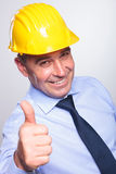 Old engineer shows thumb up Royalty Free Stock Images