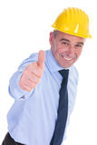 Old engineer shows thumbs up and smiles Stock Images