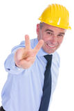 Old engineer shows victory sign Stock Photo