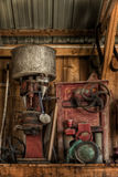 Old Engines Stored on Shelf. Antique motors stored away Royalty Free Stock Photos
