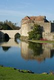 Old English castle and moat. With black swans Stock Photography