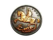 Old English Coin. Reverse side of an old English coin showing St George and the dragon Royalty Free Stock Photos