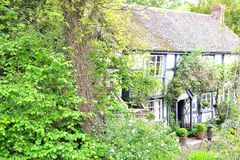 Old English cottage. Old black and white cottage in English countryside Royalty Free Stock Photos