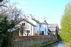 old English cottage on the river Royalty Free Stock Images
