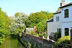 old English cottage on the river Stock Photos