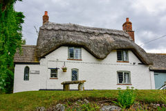 Old english house at countryside. Many homes in England are stored in the old format. They have thatched roof Royalty Free Stock Photos