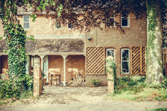 Old English house with wooden logs Vignette effect Stock Images
