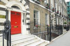 Old english houses - red door. Typical  English houses in London, England Royalty Free Stock Photography