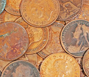 Old English Pennies. A mix of old English Pennies from a period spanning a period of more than 100 years including images of a young Queen Victoria as well as stock photos