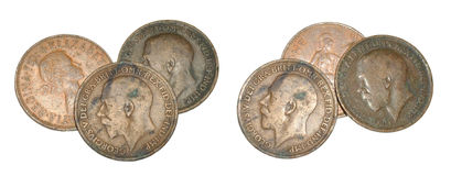 Old English Pennies. Old tarnished pre-decimal English pennies, isolated on a white background royalty free stock photos
