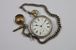 Old English pocket fob watch and chain Stock Photos