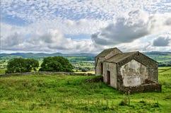 Old English stone barns Stock Photo