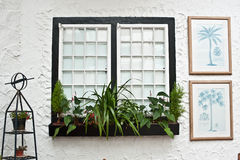 Old English tudor style decor, white windows. And picture frames Stock Photography