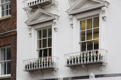 Old English tudor style decor, white windows Stock Photos
