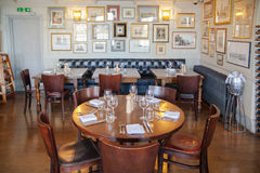 Free Old English Victorian Public House Interior. Early Morning Settings With No People Royalty Free Stock Image - 56154366