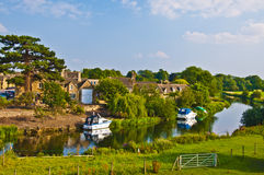 Old English village next to river Stock Photography