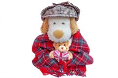 Old Englishman and teddy bear with London Love Heart. Old Dog similar to Englishman in deerstalker hat or Sherlock Holmes and teddy bear with London Love Heart Stock Photos