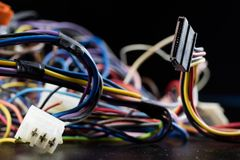 Old entangled cables, electronics and old cable connectors on a Stock Photography