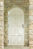 Old entrance door and stone wall architect design Royalty Free Stock Images