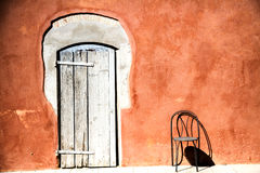 Old entrance door whit chair Royalty Free Stock Image