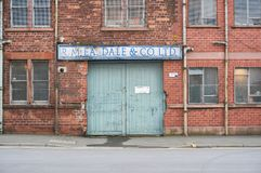 An old entrance gate to a local business in UK. An old entrance gate with a company name above for a local business in Glasgow Stock Image