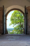 Old entrance in monastery. Beautiful view is opening thrugh the entrance door Stock Photo