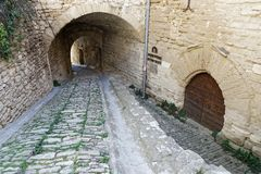 Old entrance passageway in Gordes. Old entrance passageway and door in the Provence village of Gordes Royalty Free Stock Photos