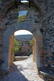 Old entrance porch in french village of Castelnou in Pyrenees Royalty Free Stock Photos
