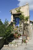 Old entrance and stairs with blue door, Provence, Stock Image