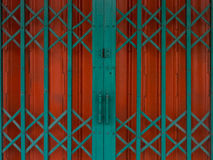 Old entrance steel door. With red and green design Stock Images